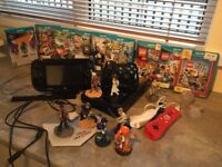 Nintendo wiiu with 7 games and joypads and figures