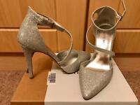 Size 6 silver heel