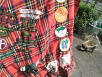 Scout camp blanket with badges - red tartan - some old badges