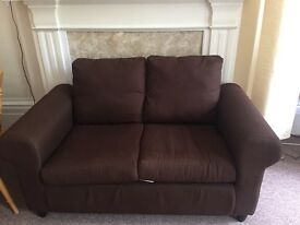Dark brown sofa to go in great condition