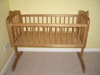 Wooden rocking baby crib