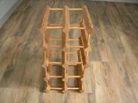 A wooden ten bottle capacity wine rack.