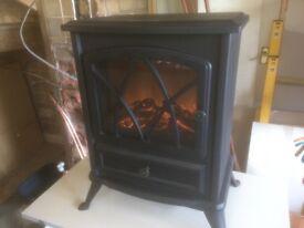 Electric fireglo fan heater in black. Unused. As new.