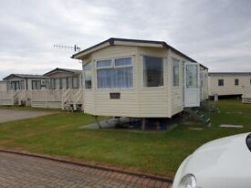 lovely static caravan on bunn leisure 3 bed very close to complex and beach