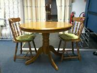 Circular pine pedestal dining table and 2 chairs. Excellent condition