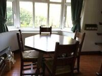 Beautiful solid dark wood table and four chairs good condition