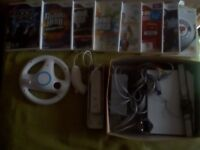 Nintendo Wii console and accessories. Steering wheel & 8 games included £30