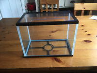 Small fish tank with perspex lid and purple gravel