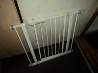 Lindam baby safety gate in good condition £10 with new holder and screws .