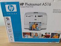 A NEW UNOPENED HP PHOTOSMART PRINTER A 516