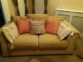 Two seater sofa bed and two arm chair