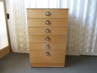 VINTAGE TEAK EFFECT SIX DRAWER CHEST OF DRAWERS.
