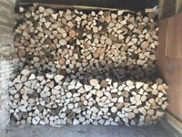 Seasoned Hardwood Logs, delivered and stacked