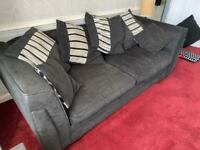 Three seater double sofa bed in black.
