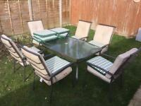 GARDEN FURNITURE SET LARGE METAL GARDEN TABLE AND 6 X STACKABLE CHAIRS & CUSHIONS CAN DELIVER 2 U
