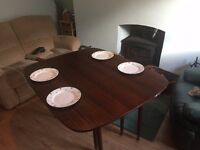 Extending dining room table with folding flaps