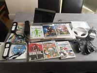 Wii bundle: 3 controllers, 2 nunchucks, 9 games, wii fit
