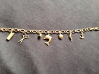 9ct gold charm bracelet, not scrap, mixed charms anchor, heart, dice, dolphin, phone, scissors
