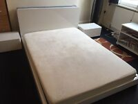 Nearly new white gloss double bed and two bedside cabinets for sale