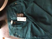 Never Worn with tags dark green skinny jeans size 10