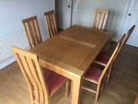 Solid beech dining table and 6 chairs.