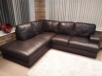 Brown leather L shaped sofa and footstool in good condition.