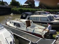 19ft sailing boat. Complete with 4hp outboard. Ready to sail