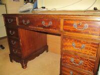 Repro mahogany knee-hole desk.