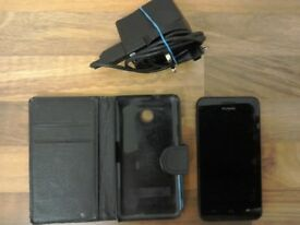 HUAWEI Y33O mobile smartphone with charger and case.
