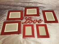 Red photo frames and love sign