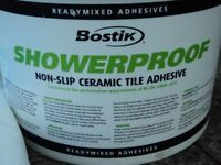 WALL TILE ADHESIVE AND WHITE GROUT.