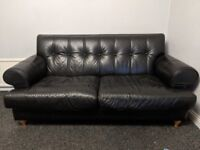 DFS black leather 3 piece suite with foot stool