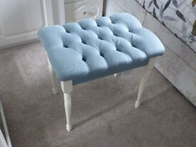Vanity stool in blue upholstery with white frame and legs