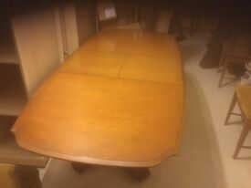 Stag dining table and 8 chairs used but plenty of life left in them yet. Now reduced to £60 ono