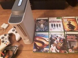 Xbox 360, 2 wireless rechargeable controllers, 10 games. Perect working order