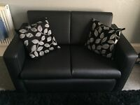 Bargain Two seater leather effect sofa