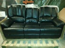 A brand new three seated black leather reclining sofa.