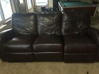 Brown leather couch and love seat recliner