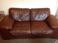 Tan leather sofa and armchair