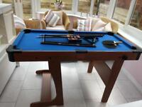 Child's pool and table tennis table