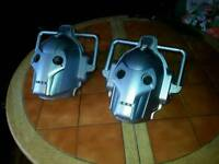 Two cybermen helmets