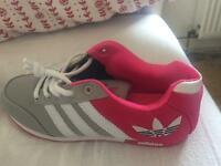 Adidas Olympic runner shoes
