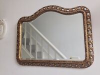 Ornate gold frame bevelled wall mirror