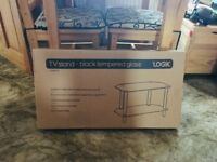 Black glass tv stand and Sony DVD player