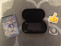 Sony PSP 3001 console and 2 games