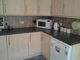 14 units and 1 tall larder unit stainless steal sink and tap and integrated extractor fan