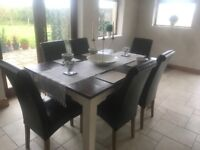Oak dining table with 6 brown leather chairs