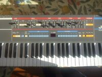 Roland Juno 106 classic polyphonic synthesizer with custom wooden sides fully working.