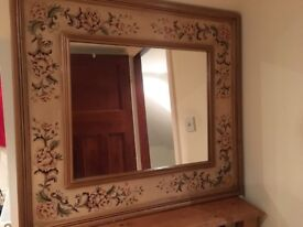 Large mirror with decorated frame