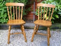 Pair of farmhouse style pine chairs